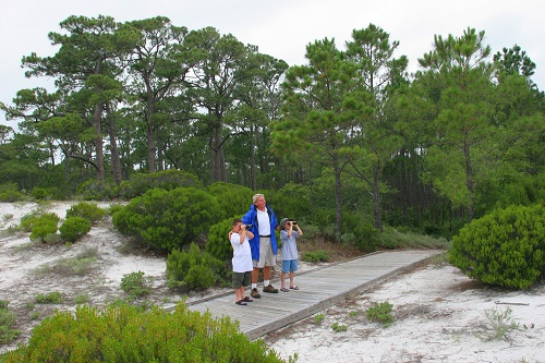 Alabama, Dauphin Island, Audubon Bird Sanctuary, naturalist, boys, binoculars, dunes, Gulf of Mexico,